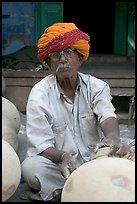 Man with turban holding a jar. Jodhpur, Rajasthan, India (color)