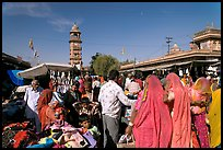 Sadar Market, with women in colorful sari and clock tower. Jodhpur, Rajasthan, India
