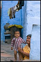 Baby girl and woman in blue alley. Jodhpur, Rajasthan, India