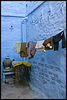 Laundry in alley with whitewashed walls tinted indigo. Jodhpur, Rajasthan, India