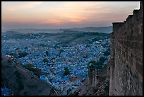 Mehrangarh Fort walls, and old city  blue houses, sunset. Jodhpur, Rajasthan, India