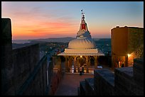 Chamunda Devi temple with man worshipping at sunset, Mehrangarh Fort. Jodhpur, Rajasthan, India (color)