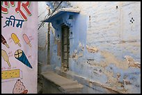 Whitewashed walls with indigo tint and ice-cream depictions. Jodhpur, Rajasthan, India