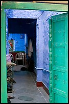Doorway and inside of a house painted blue. Jodhpur, Rajasthan, India