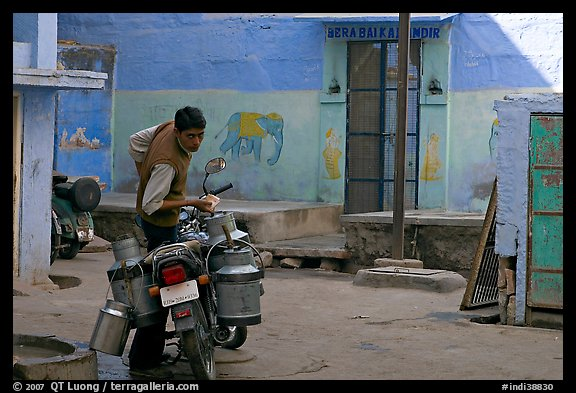 Man with milk delivery motorbike. Jodhpur, Rajasthan, India