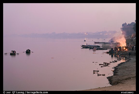 Ganges River at sunset with cremation fire. Varanasi, Uttar Pradesh, India (color)