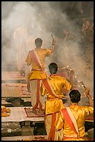 Brahmans standing amongst clouds of incense during puja. Varanasi, Uttar Pradesh, India ( color)