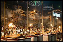 Pujari (priests) performing arti ceremony in front of large attendance. Varanasi, Uttar Pradesh, India ( color)