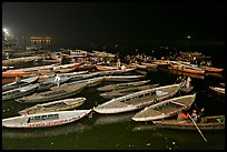 Boats on the Ganges River at night during arti ceremony. Varanasi, Uttar Pradesh, India ( color)