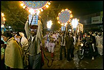Men carrying bright electric signs during wedding procession. Varanasi, Uttar Pradesh, India ( color)