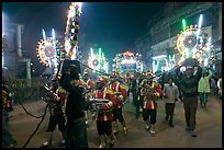 Musicians, men carrying lights, and carriage during wedding procession. Varanasi, Uttar Pradesh, India ( color)