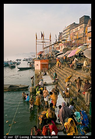 People about to bathe in the Ganga River at sunrise. Varanasi, Uttar Pradesh, India