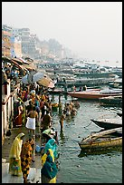 People and boats on the banks of the Ganges River, Dasaswamedh Ghat. Varanasi, Uttar Pradesh, India ( color)
