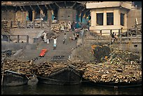 Steps of Manikarnika Ghat with body swathed in cloth and firewood piles. Varanasi, Uttar Pradesh, India ( color)
