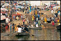 Boats and stone steps leading to Ganga River, Dasaswamedh Ghat. Varanasi, Uttar Pradesh, India ( color)