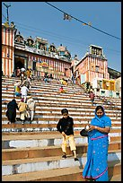 Woman and boy on temple steps, Kedar Ghat. Varanasi, Uttar Pradesh, India ( color)