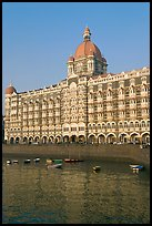 Taj Mahal Palace Hotel and small boats in harbor. Mumbai, Maharashtra, India ( color)