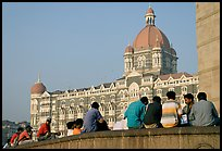 Men sitting in front of Taj Mahal Palace Hotel. Mumbai, Maharashtra, India ( color)