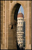 Taj Mahal Palace Hotel seen through arch of Gateway of India. Mumbai, Maharashtra, India ( color)