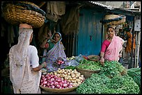 Women with baskets on head buying vegetables, Colaba Market. Mumbai, Maharashtra, India ( color)