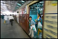 View of departing train with motion blur. Mumbai, Maharashtra, India ( color)