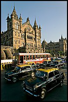 Black and Yellow cabs in front of Victoria Terminus. Mumbai, Maharashtra, India ( color)