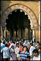 Crowd pass beneath an archway, Chhatrapati Shivaji Terminus. Mumbai, Maharashtra, India ( color)