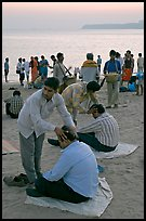 Head rub given by malish-wallah, Chowpatty Beach. Mumbai, Maharashtra, India ( color)