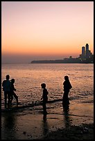 Beachgoers and skyline, Chowpatty Beach. Mumbai, Maharashtra, India ( color)