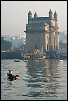 Small boat and Gateway of India, early morning. Mumbai, Maharashtra, India ( color)