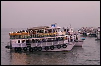 Tour boat at twilight. Mumbai, Maharashtra, India ( color)