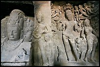 Mahesh Murti and Gangadhara Siva carved in rock, main  Elephanta cave. Mumbai, Maharashtra, India ( color)