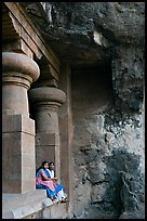 Women sitting at entrance of cave, Elephanta Island. Mumbai, Maharashtra, India ( color)