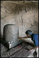 Man venerating a Linga in Shiva shrine, Elephanta Island. Mumbai, Maharashtra, India ( color)