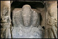 Trimurti flanked by pilasters with figures of dwarplalas, Elephanta caves. Mumbai, Maharashtra, India ( color)