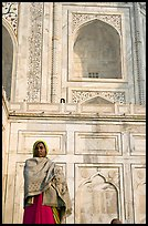 Woman standing at the base of Taj Mahal. Agra, Uttar Pradesh, India ( color)