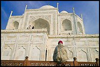 Woman sitting at the base of Taj Mahal looking up. Agra, Uttar Pradesh, India ( color)