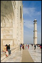 Couple sitting on side pishtaq and tourists strolling on platform, Taj Mahal. Agra, Uttar Pradesh, India ( color)