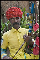 Musician with string instrument. Agra, Uttar Pradesh, India ( color)