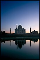 Taj Mahal reflected in  Yamuna River at sunset. Agra, Uttar Pradesh, India ( color)