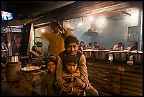 Children and food booth at night, Agra cantonment. Agra, Uttar Pradesh, India
