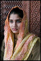 Young woman with embroided scarf, in front of Rumi Sultana wall. Fatehpur Sikri, Uttar Pradesh, India ( color)