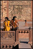 Young women sitting in the center of Ornamental pool. Fatehpur Sikri, Uttar Pradesh, India ( color)