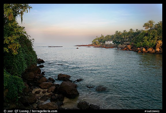 Oceanfront with house and palm trees, Dona Paula. Goa, India