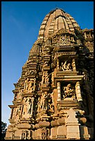 Bands of carved sculptures below spire (sikhara), Javari Temple, Eastern Group. Khajuraho, Madhya Pradesh, India (color)