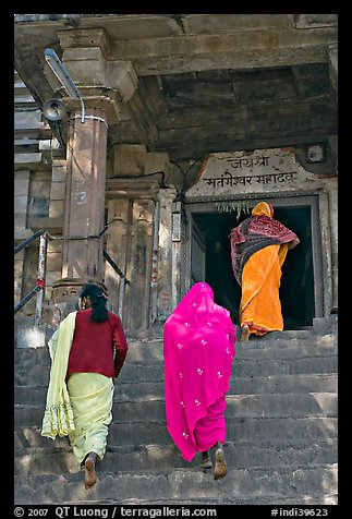 Women climbing up stairs on Matangesvara temple. Khajuraho, Madhya Pradesh, India