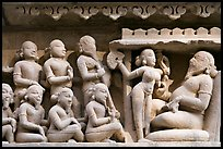Sculpture of royal court scene, Lakshmana temple. Khajuraho, Madhya Pradesh, India (color)
