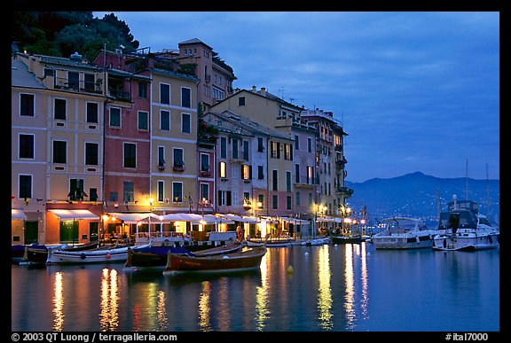 Houses reflected in harbor at dusk, Portofino. Liguria, Italy (color)