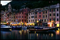 Pastes-colored houses around harbor at dusk, Portofino. Liguria, Italy ( color)