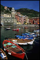 Colorful samll fishing boats in the harbor and main plaza, Vernazza. Cinque Terre, Liguria, Italy (color)